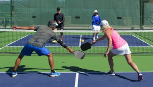 foursome playing pickleball